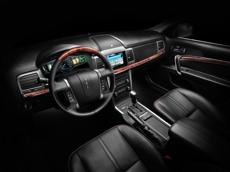 2010 Lexus LX 570 · 2011 Lincoln MKZ Hybrid