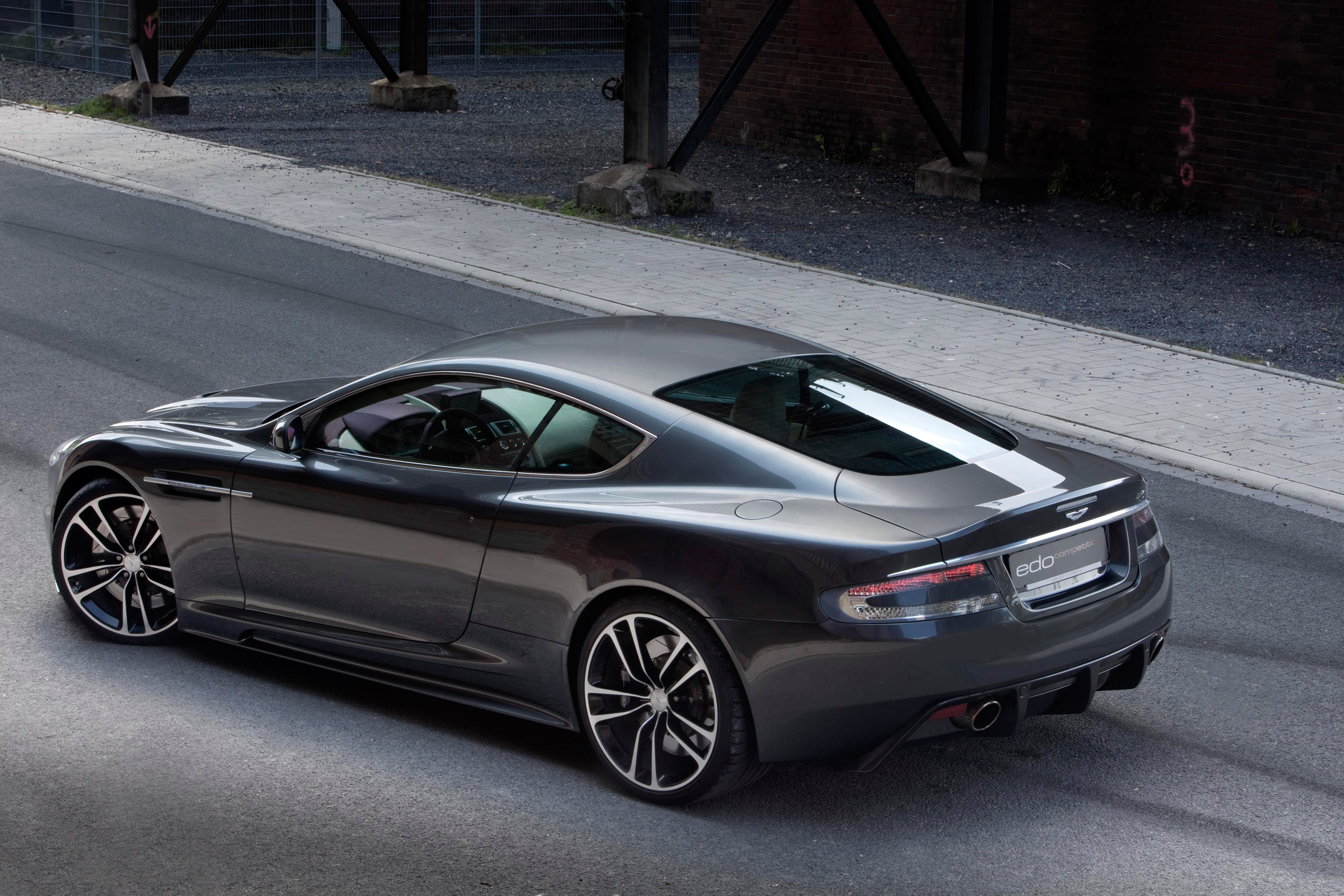 edo transforms the aston martin db9 into a full blooded dbs. Black Bedroom Furniture Sets. Home Design Ideas