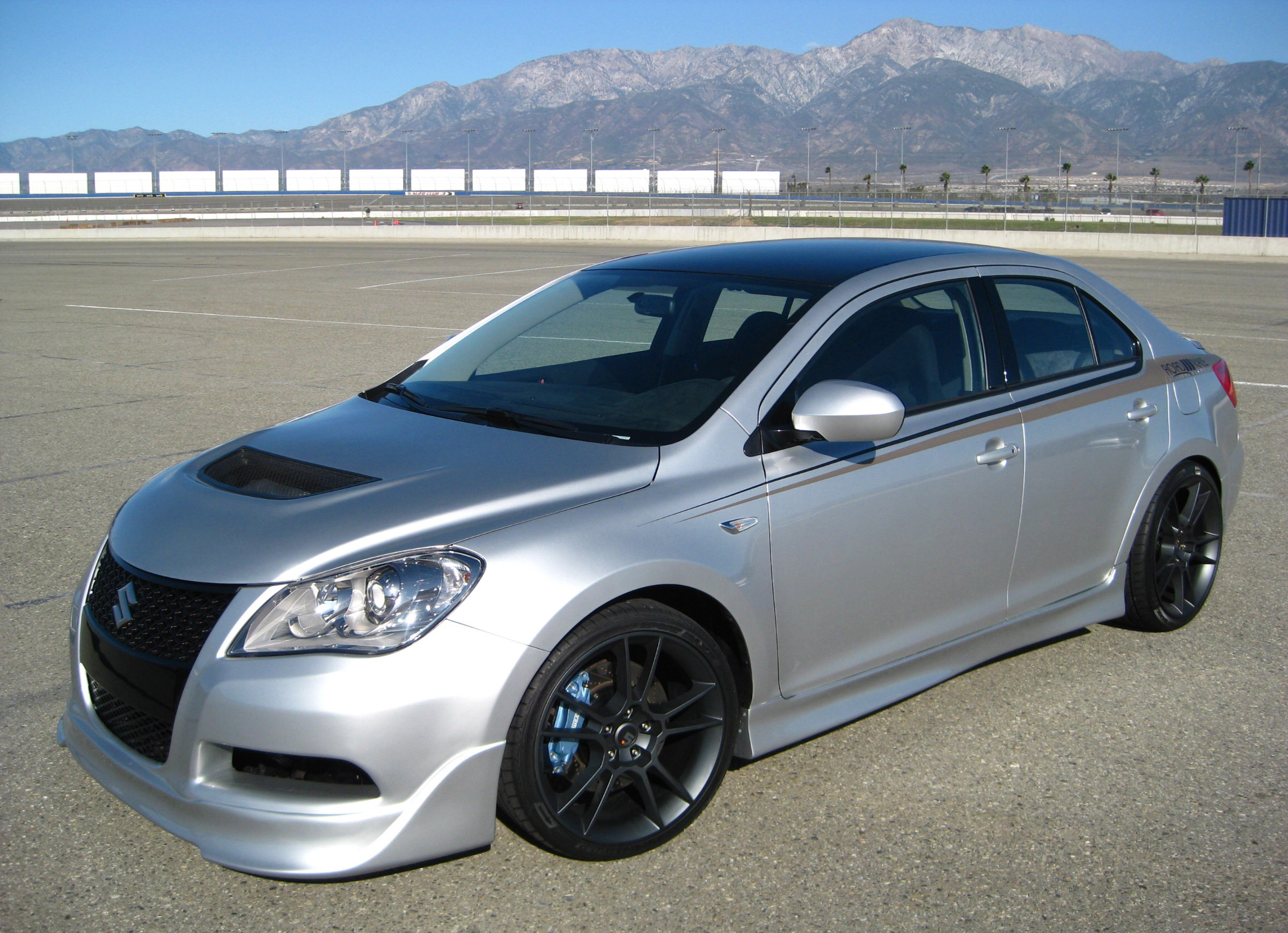 Platinum edition suzuki kizashi by road race motorsport for Gm motor club roadside assistance