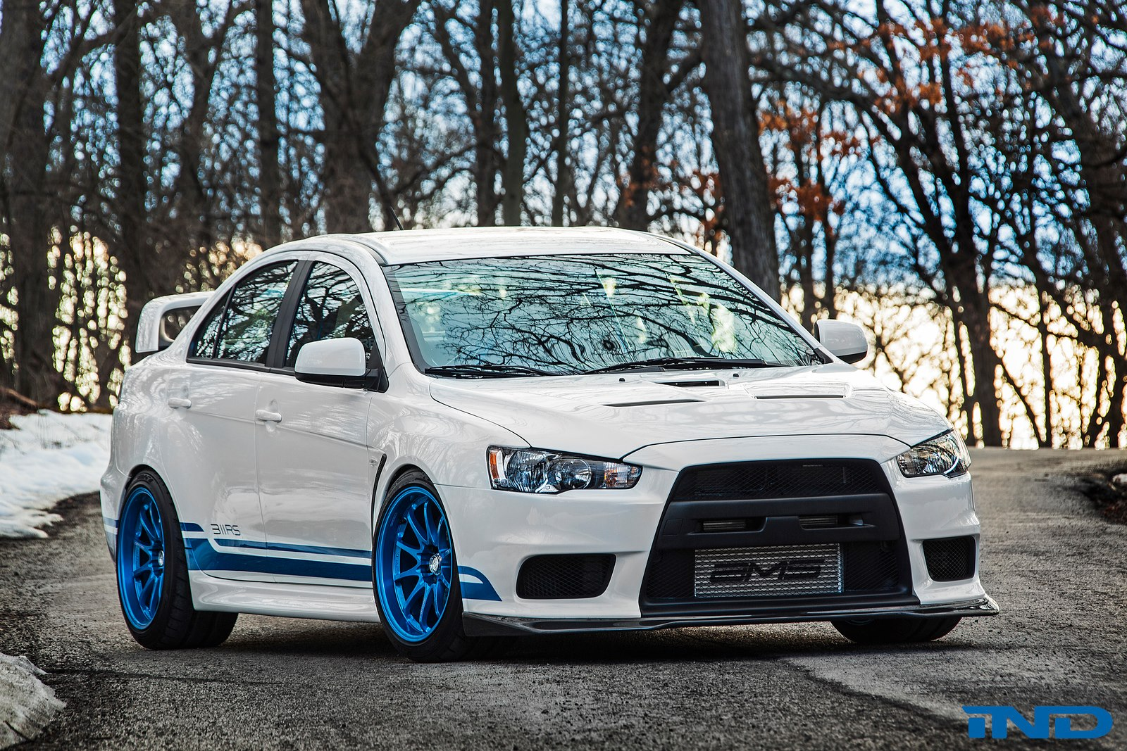 http://www.automobilesreview.com/img/ind-mitsubishi-evo-x-311rs/ind-mitsubishi-evo-x-311rs-02.jpg