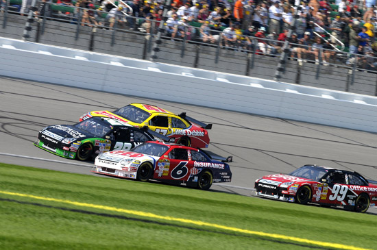 Kansas USA - David Ragan,Travis Kvapil, Marcos Ambrose and Carl Edwards battle on the front stretch