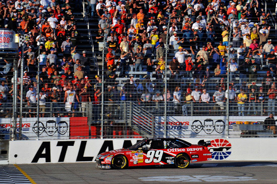 Carl Edwards takes the checkerd flag for his 7th Sprint Cup Series win