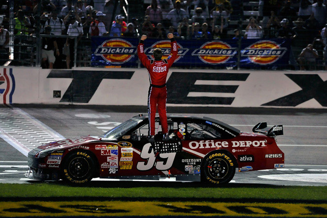 Texas USA Carl Edwards celebrates in front of the Texas crowd.