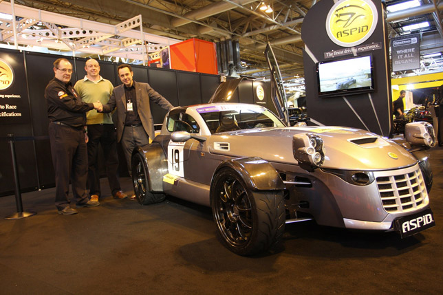 Britcar founder James Tucker, race driver Rob Hedley and IFR founder Ignacio Fernandez, pictured with IFR Aspid at the Autosport International racing car show.
