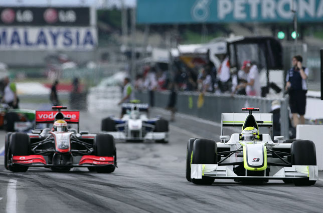 Lewis Hamilton, Vodafone McLaren Mercedes (left) besides the Brawn Mercedes of pole sitter Jenson Button
