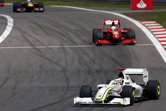Jenson Button leads Felipe Massa
