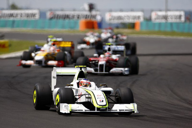 Rubens Barrichello leads a group of cars