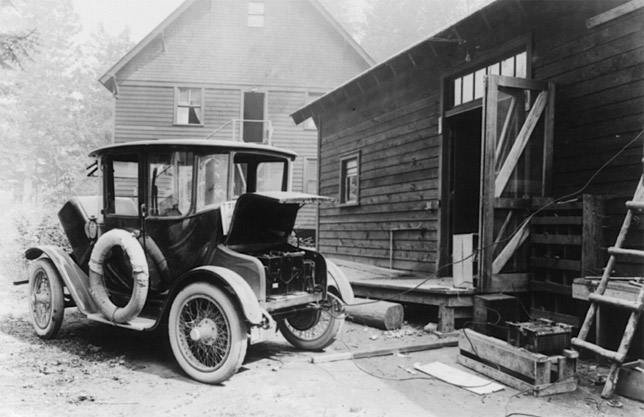 Electric car from early 20th century charging