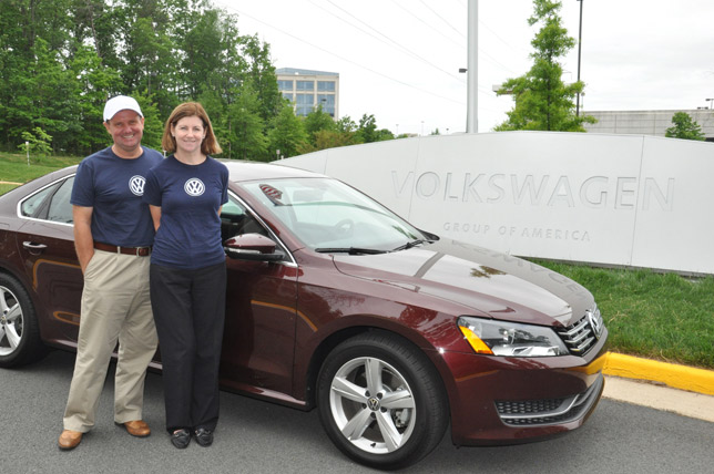 John and Helen Taylor next to the Volkswagen Passat TDI SE Clean Diesel