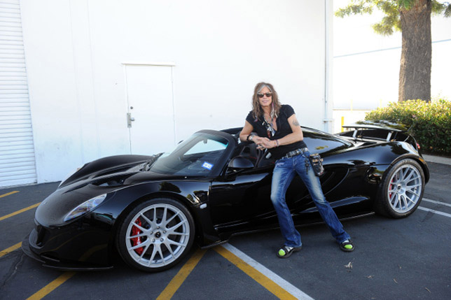 Steven Tyler next to his Hennessey Venom GT-Steven
