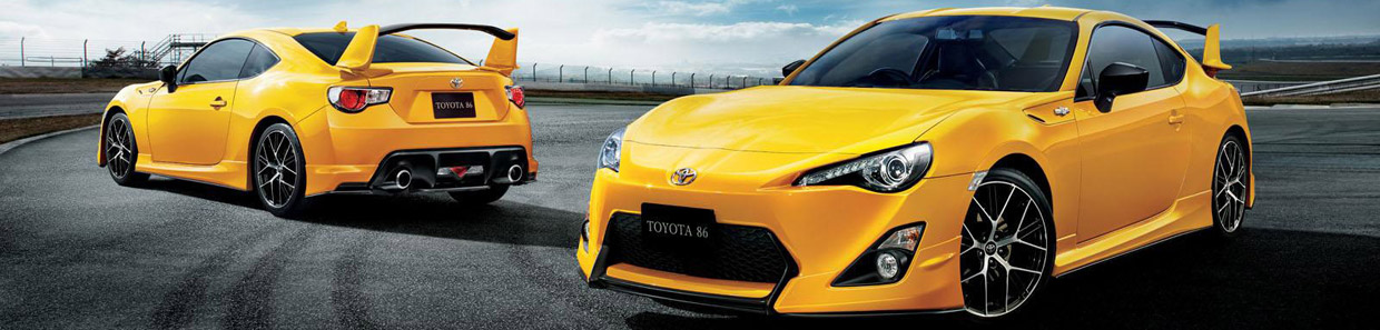 Two Toyota 86 Yellow Limited Cars