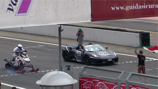 What Happens When Snowmobile Enters a Head to Head Drag Race Vs Ferrari [VIDEO]