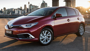 2016 Corolla Hybrid is here. Along with its long nose.